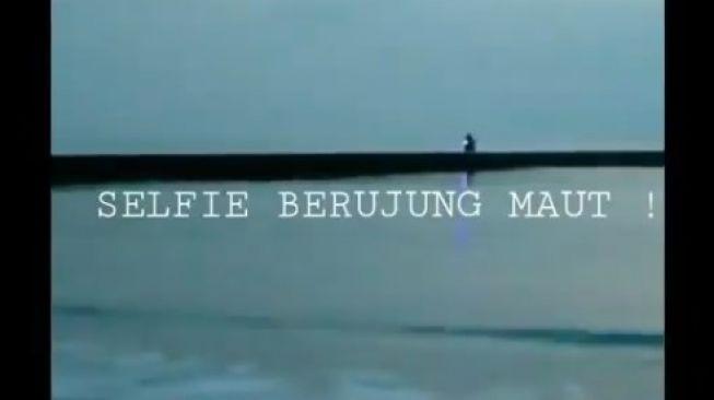 因专心自拍,一名尖美士县居民和他摩托车在Teluk Penyu一起溺水而身亡